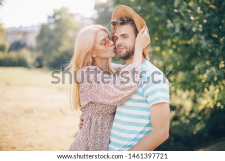 Young woman and young man are hugging and smiling #1461397721
