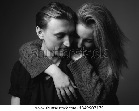 Young woman and young man are hugging. Black and white