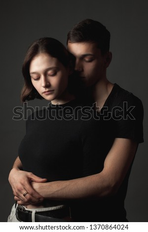 Young woman and young man hugging