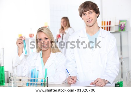 young woman and young man in a laboratory