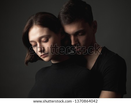 Young woman and young man in studio.