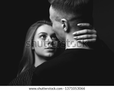 Young woman and young man in studio. Couple. Black and white.