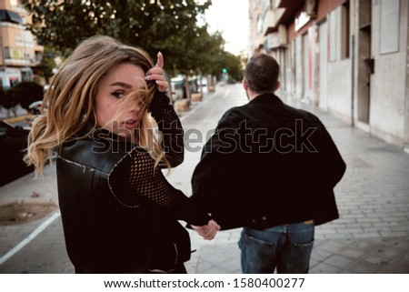 Young woman and young man street story