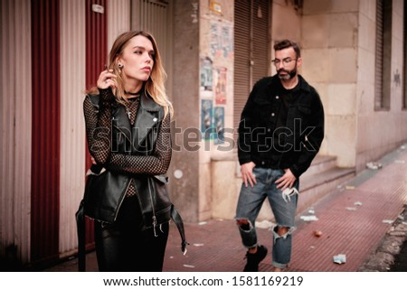 young woman and young man street story punks