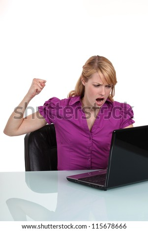 Young woman angry with her laptop