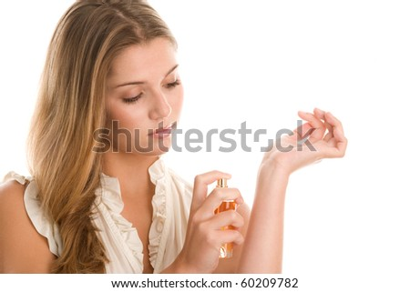 Young woman applying perfume on wrist isolated on white background