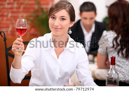 Young woman appreciating a glass of rose wine