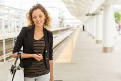 Young woman arrived to the train station in big city.