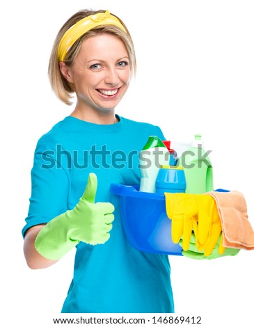 Young woman as a cleaning maid holding bucket full of liquids and showing thumb up gesture, isolated over white