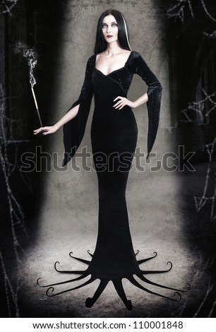 Young woman as halloween witch with cigarette on dark background