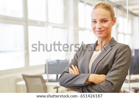 Young woman as self confident business consultant or lawyer #651426187