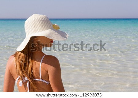 Young woman at beach of Lampedusa