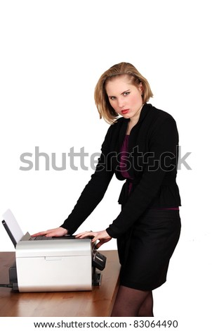 Young woman at office machine or photocopier