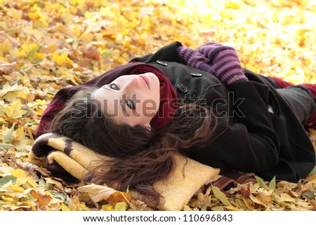 Young woman at the autumn park