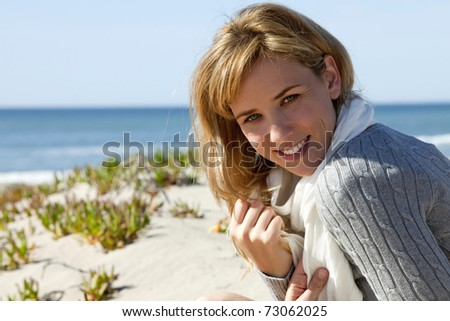 Young woman at the beach on a cold day