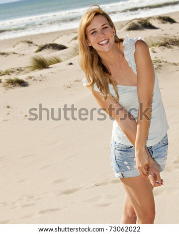 Young woman at the beach on a sunny day