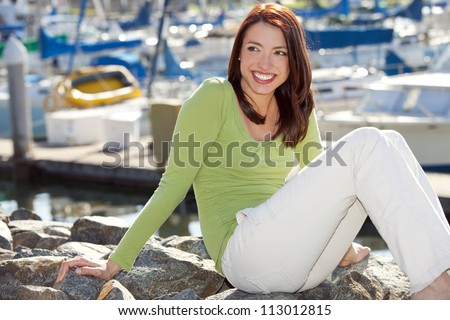 Young woman at the boat harbor