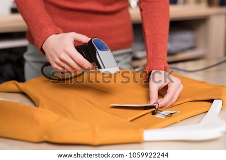 Young woman at the counter in the store