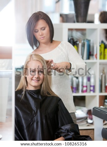 Young woman at the hairdresser salon .