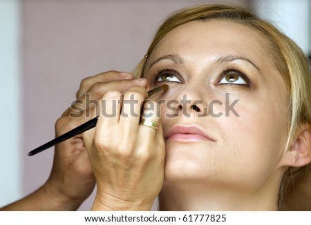 Young woman at the makeup artist.