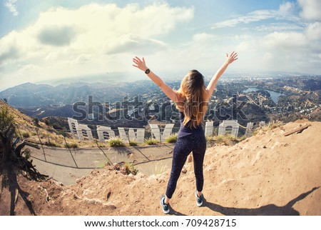 Photo of  Young woman at the top of Hollywood, Los Angeles, California