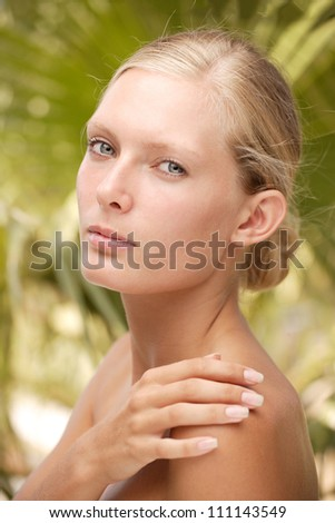 Young woman  at tropical resort