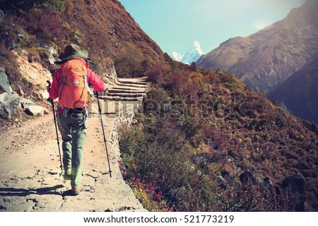 young woman backpacker trekking ...