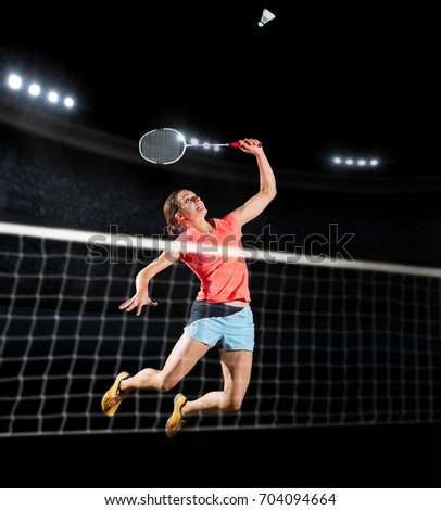 Young woman badminton player isolated (sports hall version)