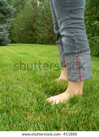 Young Woman Barefoot in Grass