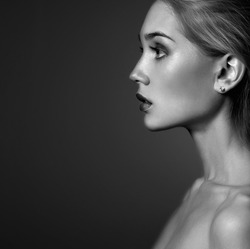 Young woman.Beautiful blonde Girl.close-up fashion monochrome portrait