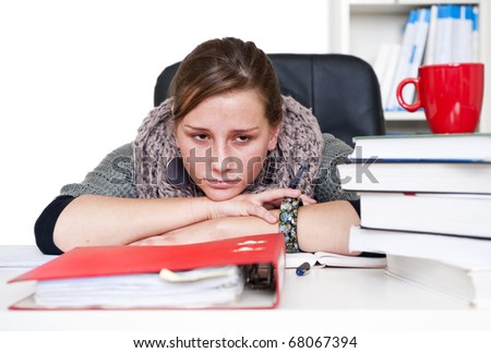 young woman being bored staring over her books and notes