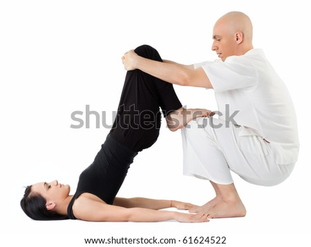 Young woman being stretched in thai position by therapist