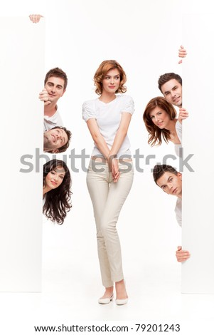 young woman between two blank boards and friends