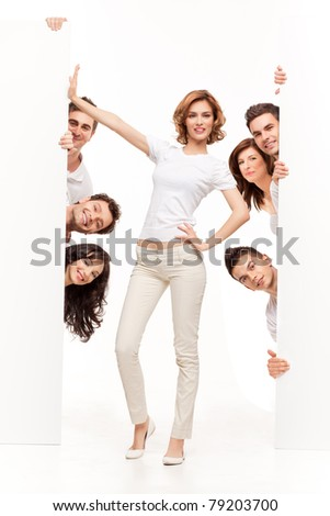 young woman between two white boards and friends - stock photo