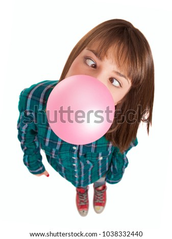 Young Woman Blowing Bubble Gum Over White Background #1038332440