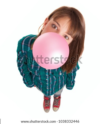 Young Woman Blowing Bubble Gum Over White Background #1038332446