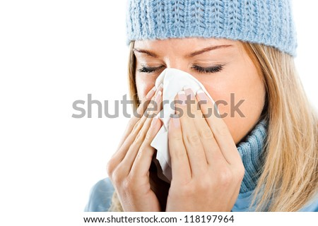 Young woman blowing into tissue,Flu