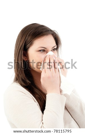 Young woman blows her nose into handkerchief