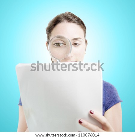 Young woman browsing a document with a magnifying glass over light blue gradient background