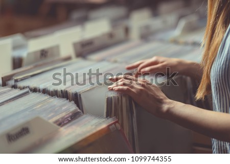 Young woman browsing records in a vinyl record store