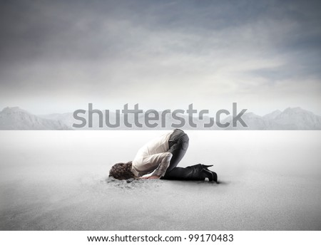 Young woman burying her head in the sand