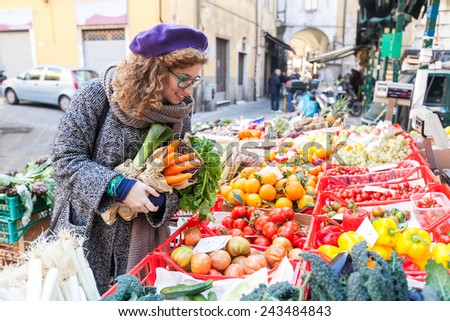 young woman buying vegetables...