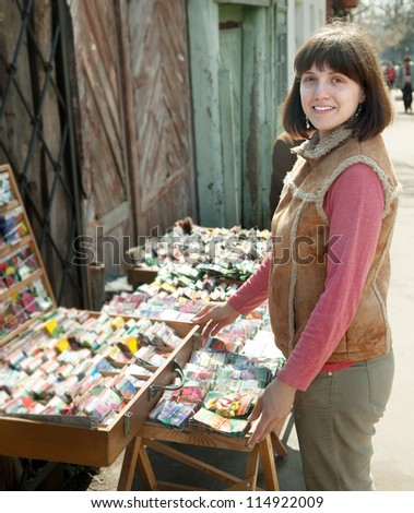 Young woman buys the seeds on the market