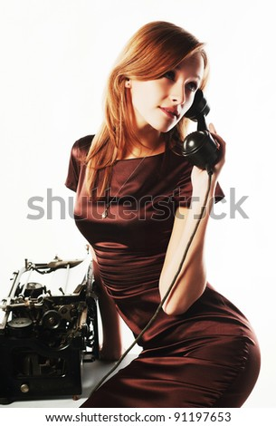 Young woman calling on the retro phone