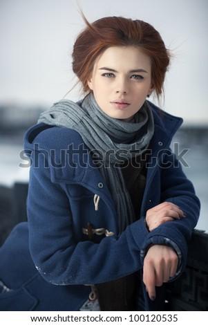 Young woman calm winter portrait.