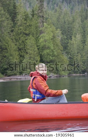 Young woman canoeing in Canada