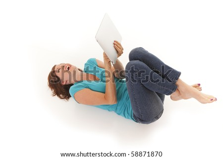 Young woman casually laying on floor with a touchscreen computer