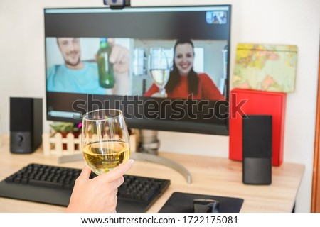 Young woman chatting and drinking wine on computer meeting room with friends - Alternative party during stay safe at home and isolation quarantine - Focus on glass