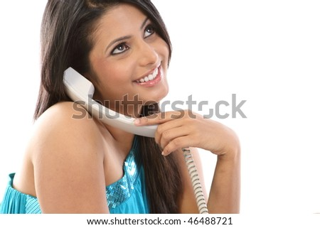Young woman chatting in the telephone receiver