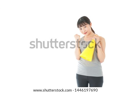 Young woman cheering sports game